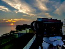 Camera. Shooting on a cityscape sunset with sea reflection, beautiful landscape royalty free stock images