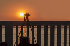 Camera,shooting a sunset landscape. Camera, with filters on a tripod shoot`ing a sunset landscape royalty free stock image