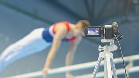 Camera shots gymnastic competitions - de-focused. Close up stock footage
