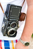 Camera on a shoulder Stock Photo