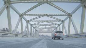 Camera Shows Beautiful Bridge with Driving Car against Clear Sky. SALEHARD, YAMAL-NENETS/RUSSIA - JUNE 15 2012: Camera moves down and shows beautiful modern stock video