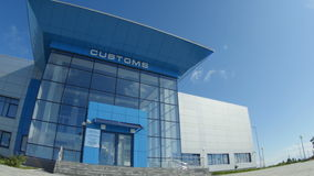 Camera Shows Large Blue Customs Building Royalty Free Stock Photos