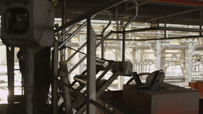 Camera Shows Worker Putting down Metal Stairs on Oil Tank. KAZAN/TATARSTAN/RUSSIA - NOVEMBER 15 2016: Camera shows worker in helmet putting down metal stairs on stock footage