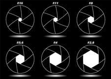 Camera shutter apertures over black Stock Images