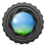 Camera shutter with grass landscape Royalty Free Stock Photography