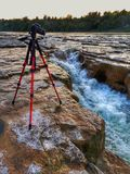 Photographing Maitland Falls Near Goderich, Ontario. Camera sits upon a tripod taking a long exposure photograph of Maitland Falls on the Maitland River at Falls Stock Photo