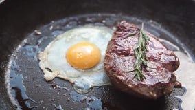 Camera slide on egg and beefsteak. stock footage