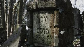 Camera slide on jewish cemetery with matzevah stock video