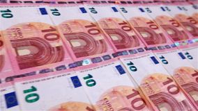 Camera sliding fast in front of small euro banknotes stock footage