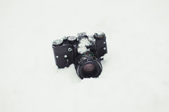 Camera on snow background Royalty Free Stock Photography