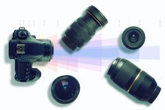 Camera and some lenses on a focal lenght graph. Photo and video technical concept. Top view and empty copy space. For Editor`s text stock photos