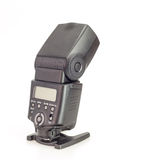 Camera speedlight flash over white Royalty Free Stock Image