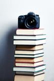 Camera on a stack of books Royalty Free Stock Photo