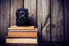 Camera and a stack of books Stock Photo