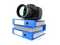 Camera on stack of ring binders Stock Images