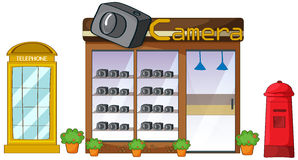 A camera store, mailbox and telephone Stock Images