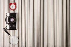 Camera on stripy background Stock Photography