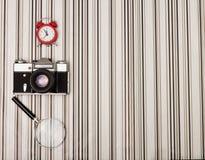 Camera on stripy background Royalty Free Stock Photography