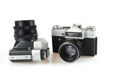 The camera in style of a retro. Is isolated on a white background Royalty Free Stock Photo