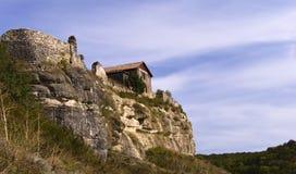 Camera su una roccia Immagine Stock