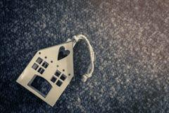 Camera sulla casa dolce casa del tappeto Fotografie Stock Libere da Diritti