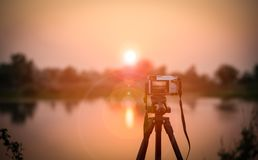 Camera and sunset Stock Image