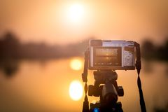 Camera and sunset Stock Photography