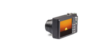 Camera with sunset on white Stock Photos