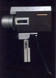 Camera Super 8. Old metal camera with Super 8 mm movie film royalty free stock photo