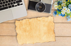Camera and supplies on office wooden desk table Royalty Free Stock Photography