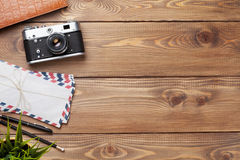 Camera and supplies on office wooden desk Stock Photo