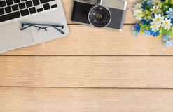 Camera and supplies on office wooden desk table Stock Photos