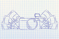 Camera surrounded by cash, concept of selling photos Royalty Free Stock Photography