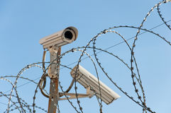 Camera surveillance and barbed wire Royalty Free Stock Image