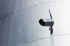 Camera surveillance drum silvery background Stock Image