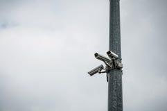 Camera surveillance fence Stock Images