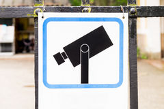 Camera surveillance sign hanging on a gate Stock Images