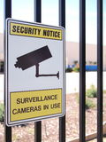 Camera surveillance sign on a steel fence of an industrial estate Stock Images