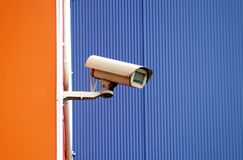 Camera surveillance on the wall of the building royalty free stock photo