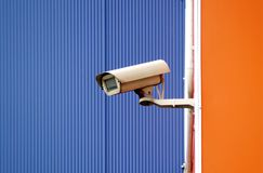 Camera surveillance on the wall of the building stock photography