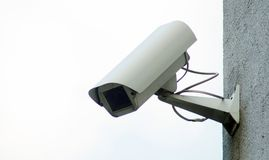 Camera surveillance on the wall of the building. royalty free stock image