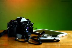 Camera, tablet and eyeglasses Royalty Free Stock Images