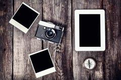 Camera, tablet and photos Royalty Free Stock Photos