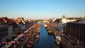 The camera takes off over the old canal of Copenhagen, Denmark. bridge in Nyhavn New Harbour canal and entertainment