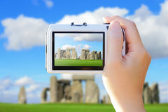 Camera taking photo with Stonehenge stock images