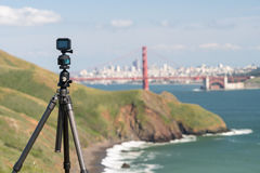 Camera taking timelapse of San Francisco. Focus on camera taking video or timelapse footage from Marin Headlands with the Golden Gate Bridge and San Francisco Stock Photos