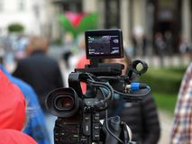 Camera. Television , a TV report, turn the material, scene filmed filming warsaw royalty free stock image