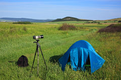 Camera, tent, backpack Royalty Free Stock Photography