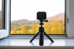 Camera timelapse on the white window sill. Timelapse camera on the window sill camera, person, sill, standing, lifestyle stock photo