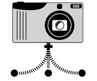 Camera on tripod. Stylized  illustration of a compact camera on a mini tripod. (Grayscale Royalty Free Stock Images